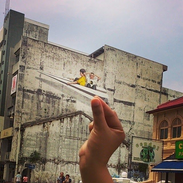 by Ernest Zacharevic New mural in Ipoh, Malaysia - 19.06.2014