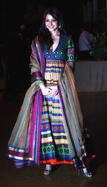 Actress Anushka Sharma goes all vibrant in an Abu-Sandeep outfit. - Feme Fashions