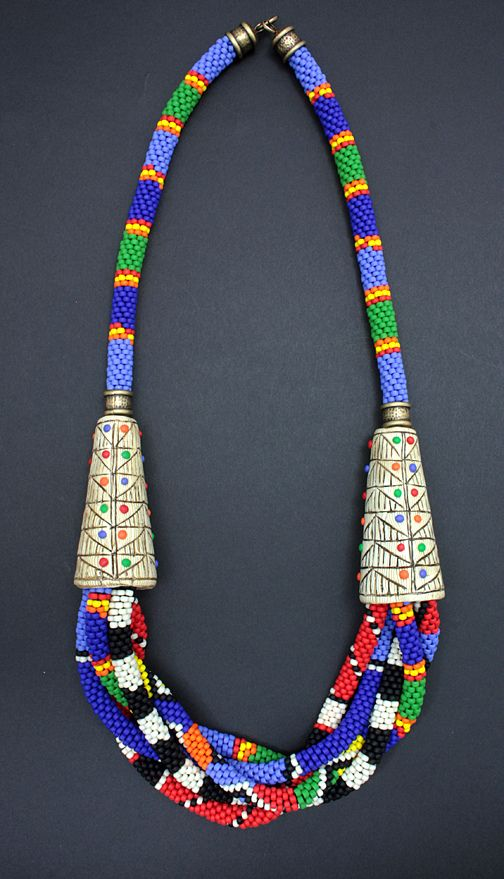 Dorothy Siemens  Tribal Ropes Necklace  Crochet bead ropes with polymer faux bone cones, inspired by Masai beadwork. Measures 28 inches