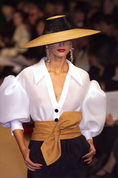 Yves Saint Laurent elegant hat and white blous, at Couture Fashion Week, Spring 2001 (See Complete Gallery)