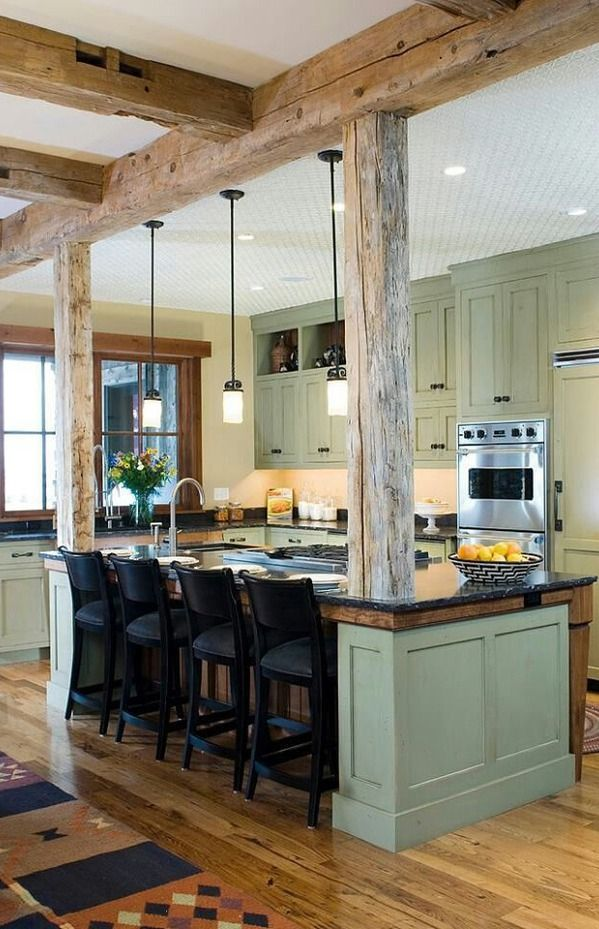 Modern rustic kitchen - love the wood and the sage green cabinets