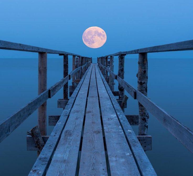 Super moon rising over lake Winnipeg, Manitoba, Canada.