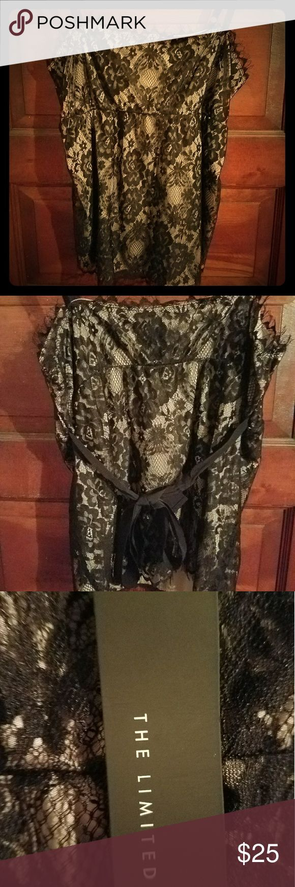 The Limited Black Lace Cami Top NWT NWT black lace over nude cami top with adjustable straps and ribbon tie in back. Pairs well with a black suit for career wear or with jeans for casual wear. The Limited Tops Camisoles
