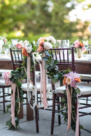 The prettiest floral adorned sweetheart chairs: http://www.stylemepretty.com/new-york-weddings/2015/09/28/intimate-whimsical-lake-placid-wedding/ | Photography: Tracey Buyce - http://www.traceybuyce.com/