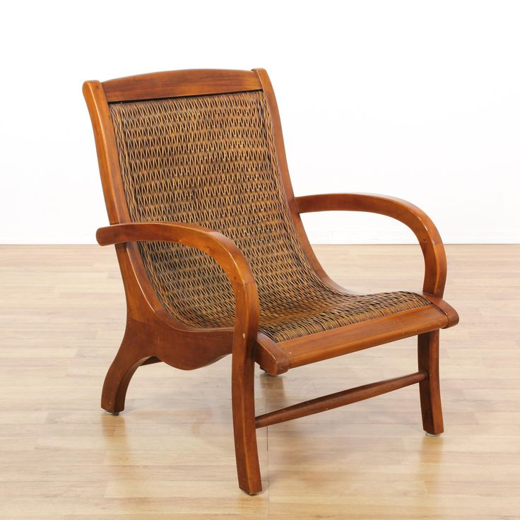 This tropical armchair is featured in a solid wood with a glossy cherry finish. This bohemian accent chair has unique curved arms, stretchers and a woven wicker back and seat. Eye catching chair great for lounging on a patio or porch! #coastal #chairs #armchair #sandiegovintage #vintagefurniture