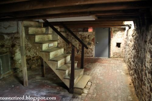The steps down into the basement