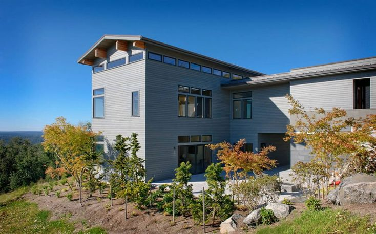 This home has some lovely interiors.  A 3-story box, clerestory windows, and post & beam roof...  it's the natural direction of our project given the site and existing home.  Note to self:  Don't.