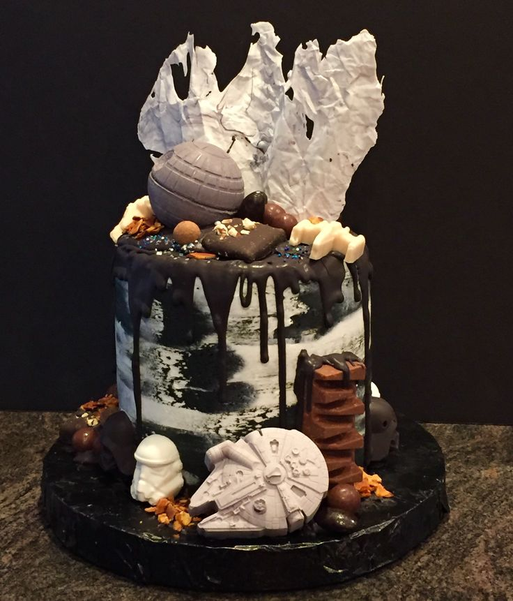 Star wars drip cake with molded chocolate decorations