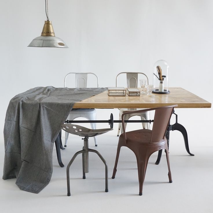 Sauvage Interiors Le Grand Cru industrial pendant #industrialpendant #industrialdining #pedestaldiningtable #parquetrytable