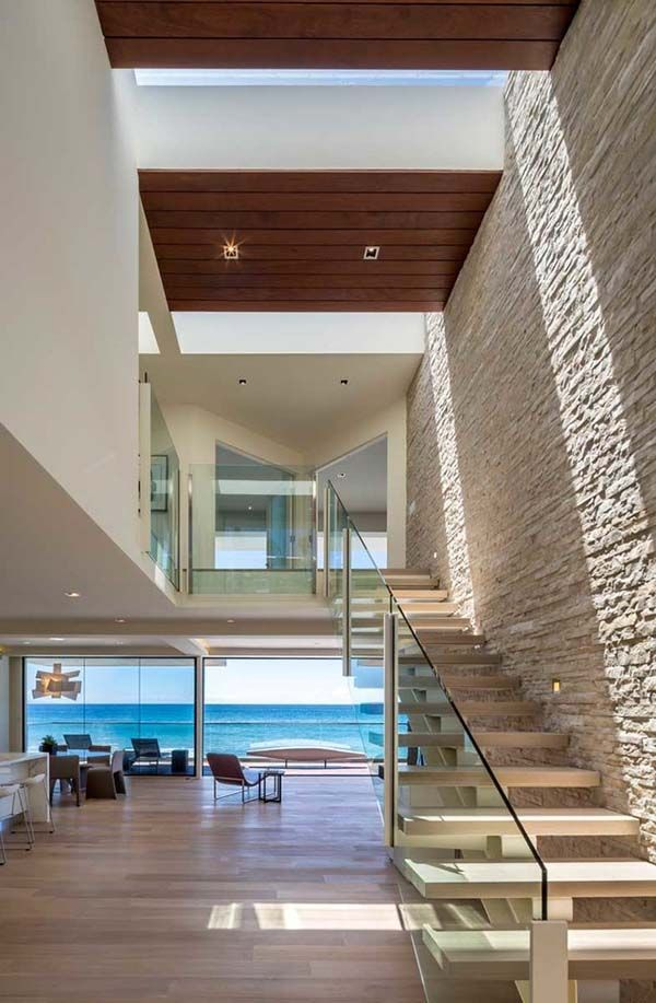 Weekend house built over the waves and sand of Malibu Beach by by Mark Dziewulski Architect