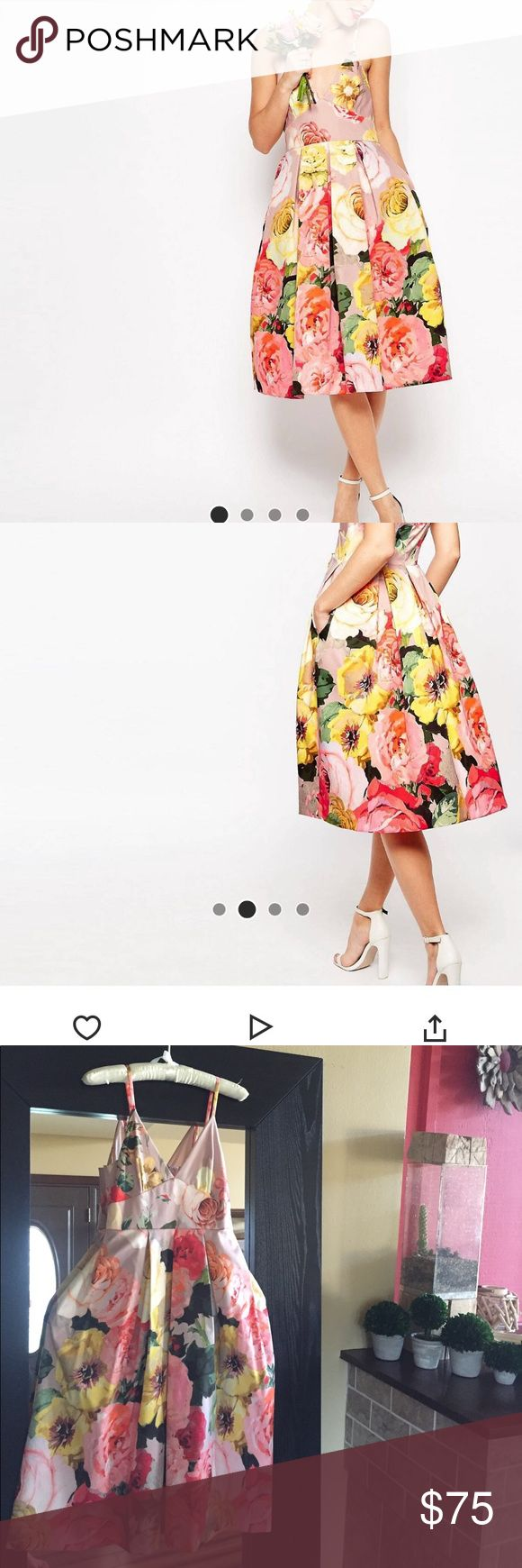 Asos Beautiful floral tea party dress with pockets Asos Beautiful floral tea party dress with pockets. Worn once for a bridal shower. Comes from a smoke free/ pet free home. Fully lined. Asos Dresses Midi