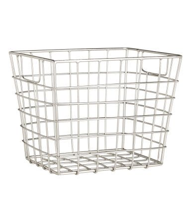 Black. Metal wire basket with handles at sides. Size 5 x 5 1/2 x 6 1/4 in.