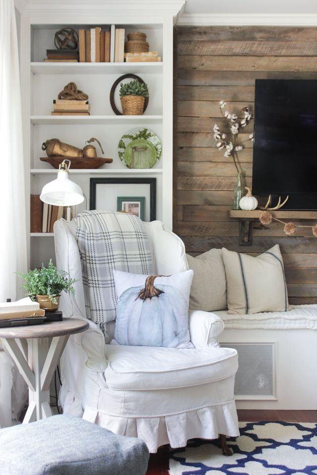 A tour around a rustic farmhouse family room decorating with natural tones of…