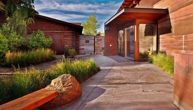 Lush green landscapes with SIREWALL and other natural building materials   Sublette County Library – SIREWALL   Structural Insulated Rammed Earth