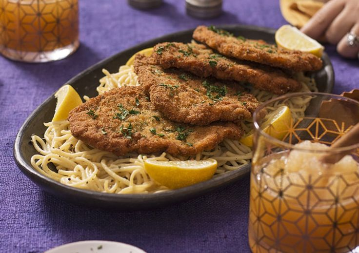 Friendsgiving is great, because you don't have to stick to the classics. Case in point: this pairing of pork Milanese with creamy cacio e pepe spaghetti.