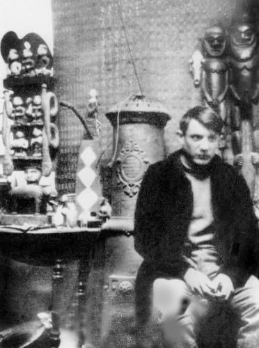 Picasso at the studio of the Bateau Lavoir, 1900.