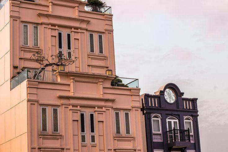 Colourful buildings line the streets in Hanoi. #gosquab #travel #hanoi #vietnam #architecture #pink #sky