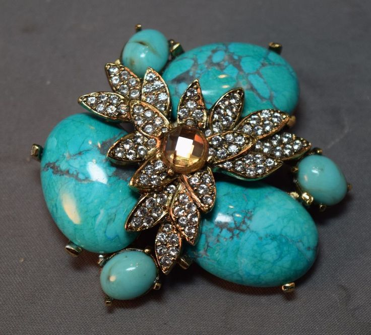 The pin has fabulous large glass faux turquoise cabochons on the bottom layer. Over the top of those stonbes is a multi-petaled flower totally embedded with sparkling crystal rhinestones. In the center of all those petals is a faceted champagne colored larger rhinestone. | eBay!