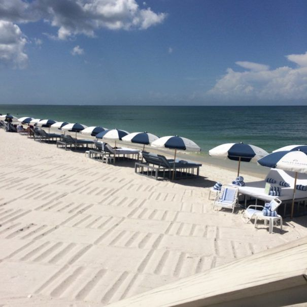 The Naples Grande Beach Resort is a gorgeous resort with many features families will love - especially their water slide that twists 100 feet around a rock tower through landscaped waterfalls. The Best Gulf Coast Family Resorts in Florida - Along for the Trip