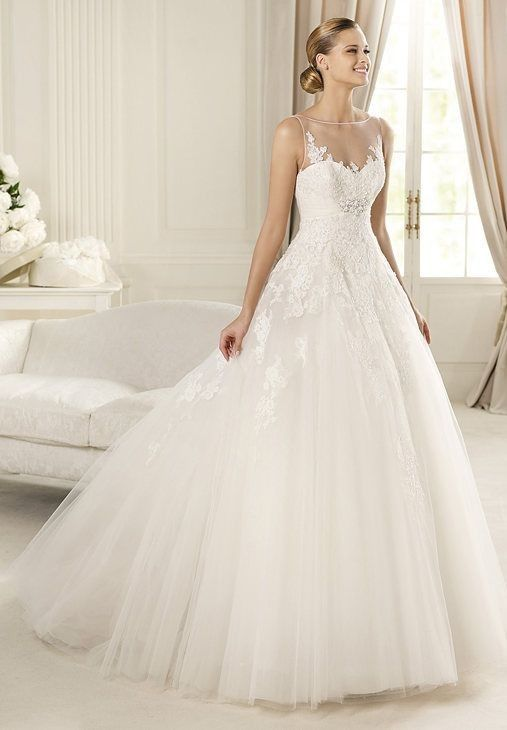 1.Bateau Ball Gown Elegant Tulle Wedding Dress  2.Elegant Wedding Dress with Sophisticated Lace Appliques Flattering the Fitted Bodice and Beaded Accent Embellishing the Empire Waist  3.Floor Length Wedding Dress with Ethereal Full Skirt and Chic Chapel Train
