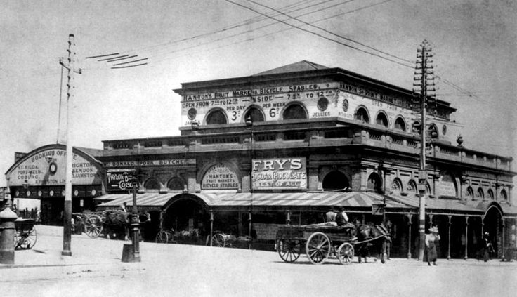 Next to the old Flinders Street Station (left of pic) on the south-west corner of Flinders and Swanston Streets stood the Old Fish Market, later housing Hanton's Fresh Fruit and Vegetable Market and Bicycle Stables. Demolished in 1900 to make way for the new Flinders Street Station. (nice ad for Fry's chocolates on building)