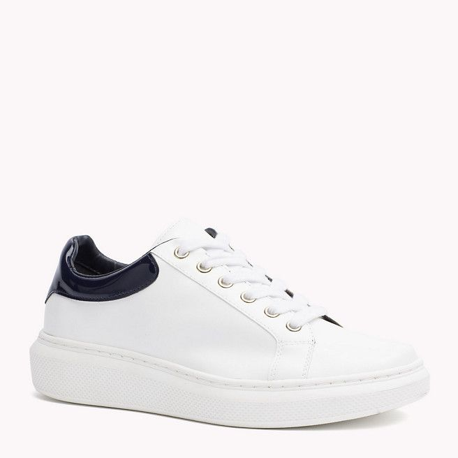 5d62a6242 Low cut white sneaker with thick sole and contrast back panel ...