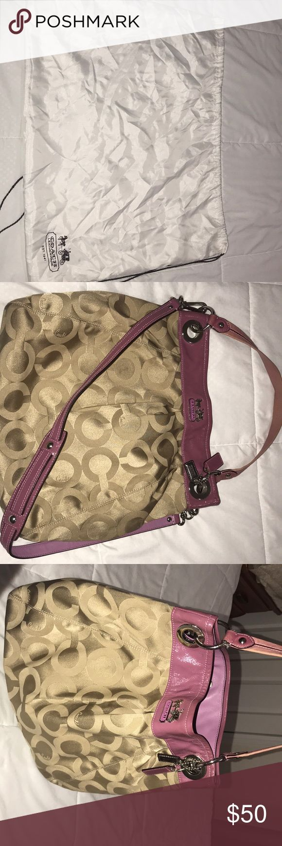 Coach hobo bag Beautiful Coach hobo style bag in khaki OP ART with lavender/purple accents and silver hardware. This bag is so roomy and holds so much! 2 strap design gives you the option to wear it many ways! Can be worn crossbody, on the shoulder, or simply on your wrist. There are some small stains on the bag but they will come out if you try to clean it.  100% authentic smoke free and pet free home Coach Bags Hobos