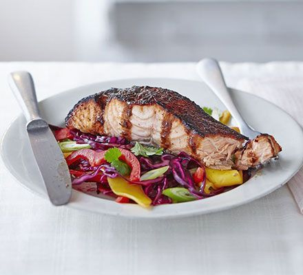 Sticky jerk salmon with mango slaw. Serve chunky salmon fillets with a spicy Caribbean honey glaze on a homemade coleslaw with cabbage, red pepper, mango and coriander