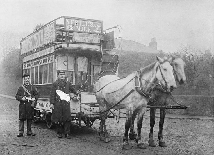 Black and white copy negative.  Shows the conductor and driver, John Brown, standing beside their horse-drawn tram at Leith, Midlothian, c. 1871
