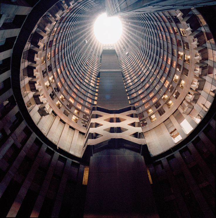 The 54-story (567.6 ft or 173 m) high Ponte City Apartments, Johannesburg, South Africa, designed by Manfred Hermer, opened in 1975.