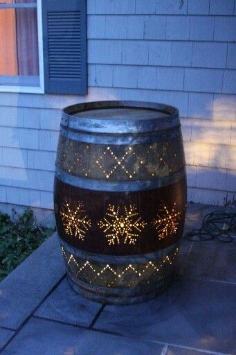 Wine barrel light for front stoop or porch. Bet you could do a different pattern on backside and get a double season out of it- like leaves on the other side.