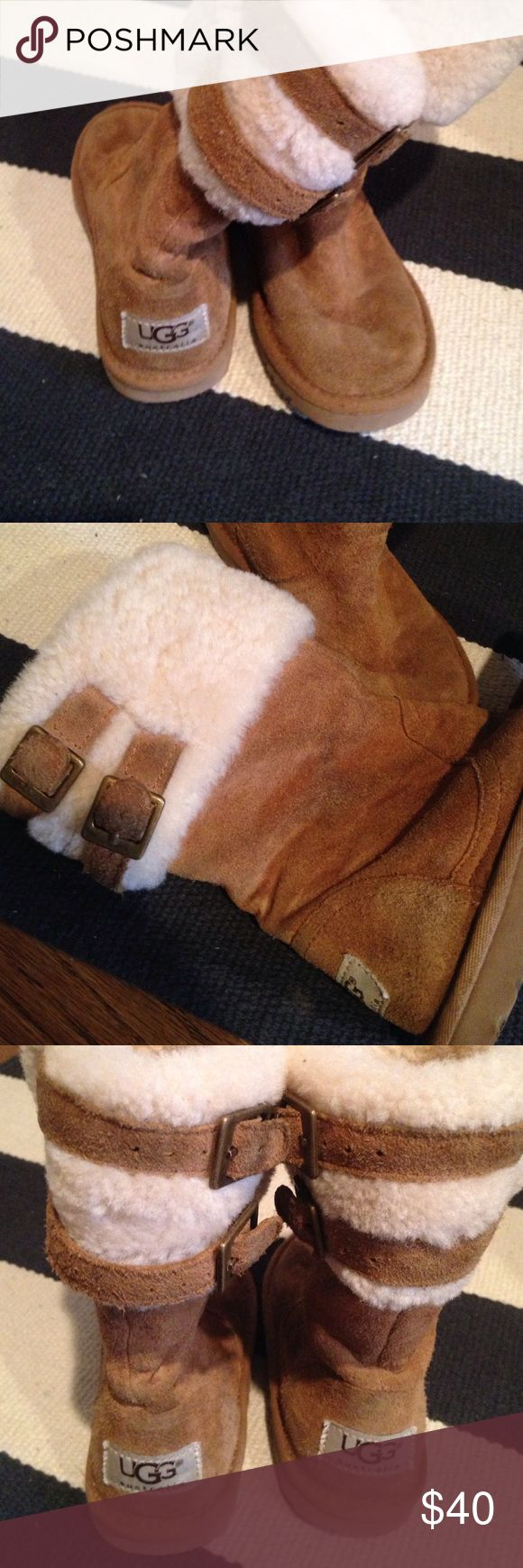 Girls Ugg boots Super cute tan Ugg boots. Double buckle detail. Some markings from wear but overall in good shape, no tears. UGG Shoes Winter & Rain Boots