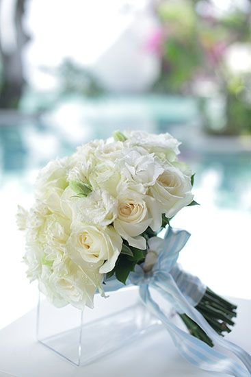 White Lisianthus & Rose bouquet tied with baby blue stripe ribbon by Tirtha Bridal Uluwatu Bali