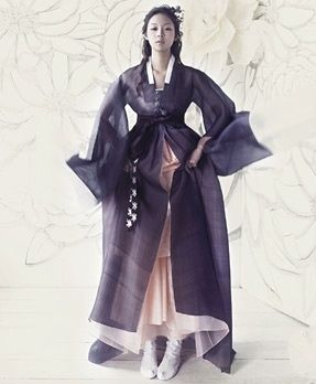Kyung Lim hanbok. Modernised hanbok in deep purple against soft pastel pink. Transparent fabrics layered on top of one another creating voluminous bottom half of figure. Look into sleeve treatments and neckline finishes.