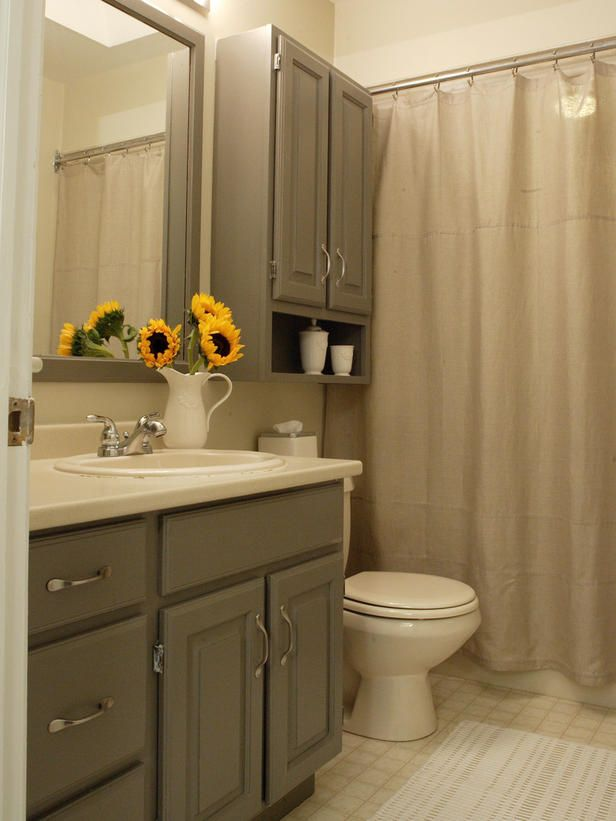 From the cabinets to the curtains, this bathroom has a washed-over gray that really makes the sunflowers pop.