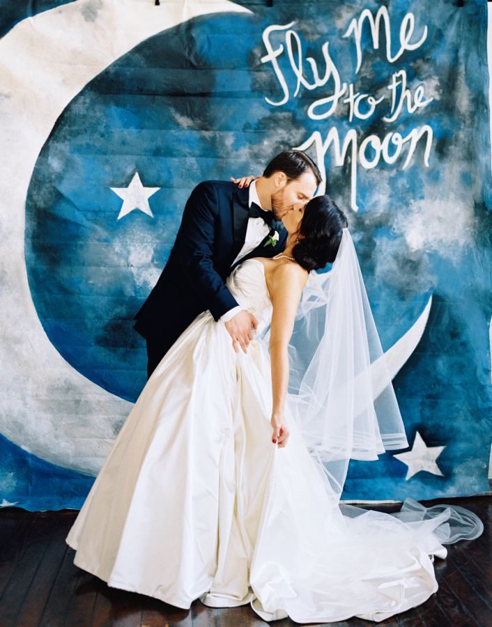 "Adorable ""fly me to the moon"" backdrop: http://www.stylemepretty.com/little-black-book-blog/2016/02/25/classic-elegant-fall-dallas-wedding/ 