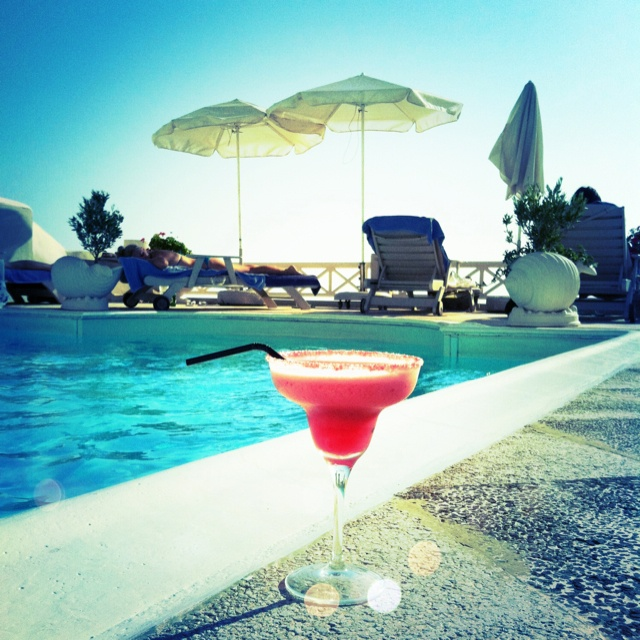 Cocktails by the pool in Santorini. Never want to wake up from this dream!