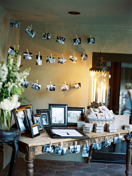 Sami, remember our antique photo frame feature wall? I love this idea for a guest book area + the photos pegged to string!