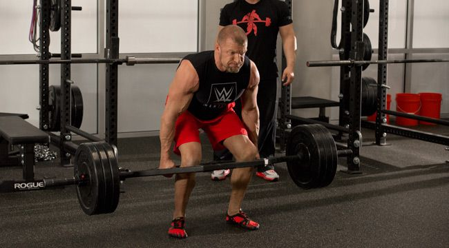 Coach Joe Defranco re-built Paul Levesque's body with mobility, strength, and power training.