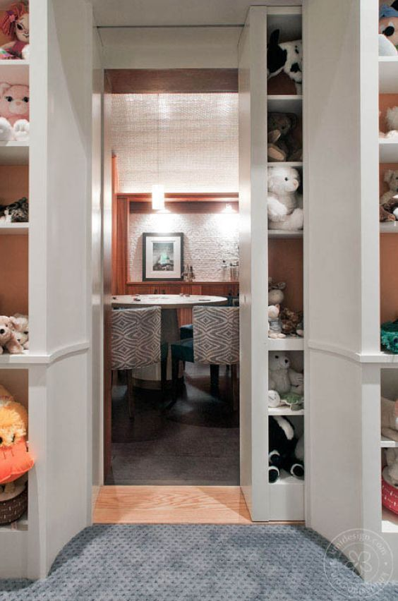 Man Caves Entry : Secret entrance to man cave behind a bookcase interiors