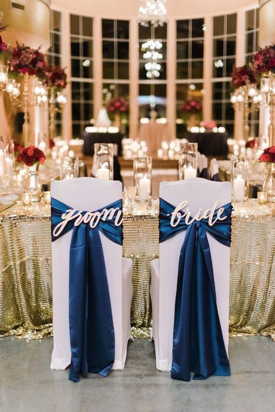 navy blue and gold bride and groom wedding chair ideas / http://www.deerpearlflowers.com/navy-blue-and-white-wedding-ideas/