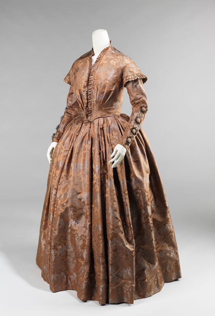 "Evening Ensemble, circa 1845-1850, American, silk. ""Originally, support came from multiple layers of petticoats which, due to weight and discomfort, were supplanted by underskirts comprised of graduated hoops made from materials such as baleen, cane and metal. The fashions during this time allowed the textiles to stand out because of the vast surface areas of the skirt and a relatively minimal amount of excess trim."""