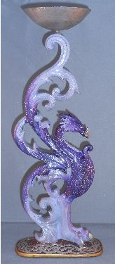 Purple Dragon Candle Holder from Absolute Angels This funky purple candle holder is of a mythical dragon with the candle holder held aloft by the dragons wings £7.99