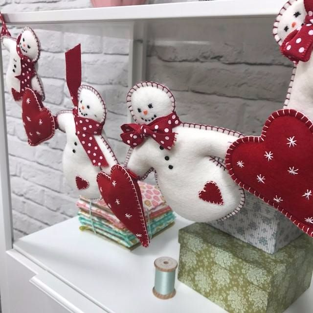 Snowman garland...use red/white bakers twine for ties and burlap hearts.