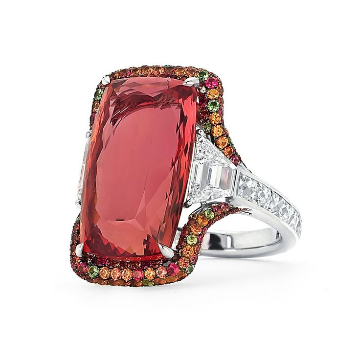 Martin Katz New York collection ring in white gold, set with an 18ct Imperial topaz and two step-cut trapezoid diamonds, micro-set with diamonds, sapphires, tsavorite garnets and tourmalines.