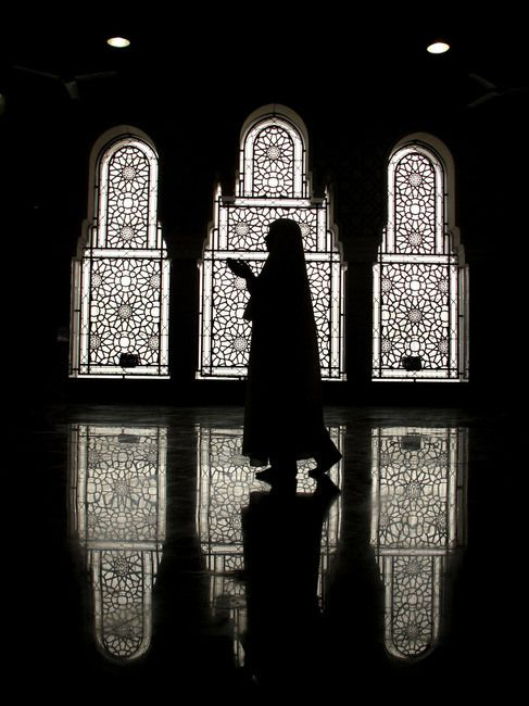 Mecca, Saudi Arabia - April 28, 2009: Muslim woman praying in Kaaba Mecca