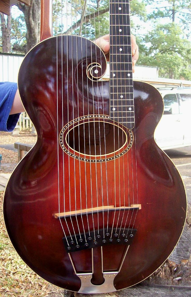 1918 Harp Guitar? WHAT? I've never heard of this instrument. Is there a violin guitar out there somewhere? Don't understand.