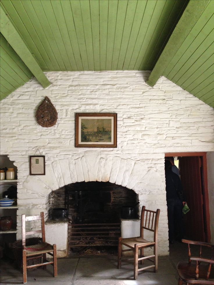 white washed stone walls and green painted timber clad ceiling interior irish cottage