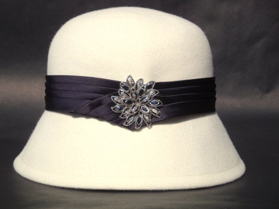 This vintage inspired hat makes you think of the 1920's hat era. This hat body was formed using the traditional cloche blocks. The crown is a