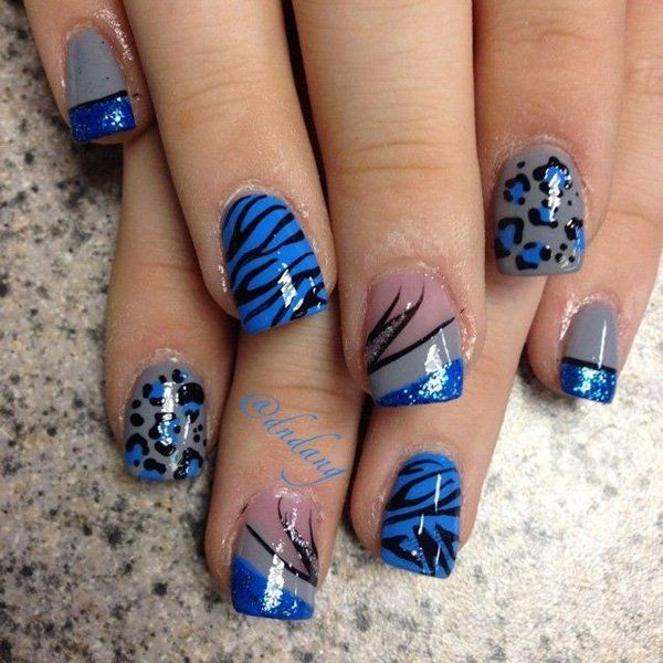 Flashy animal prints nail art design. The all blue themed nail art design also sport creative French tips with black polish for details and silver glitter polish.